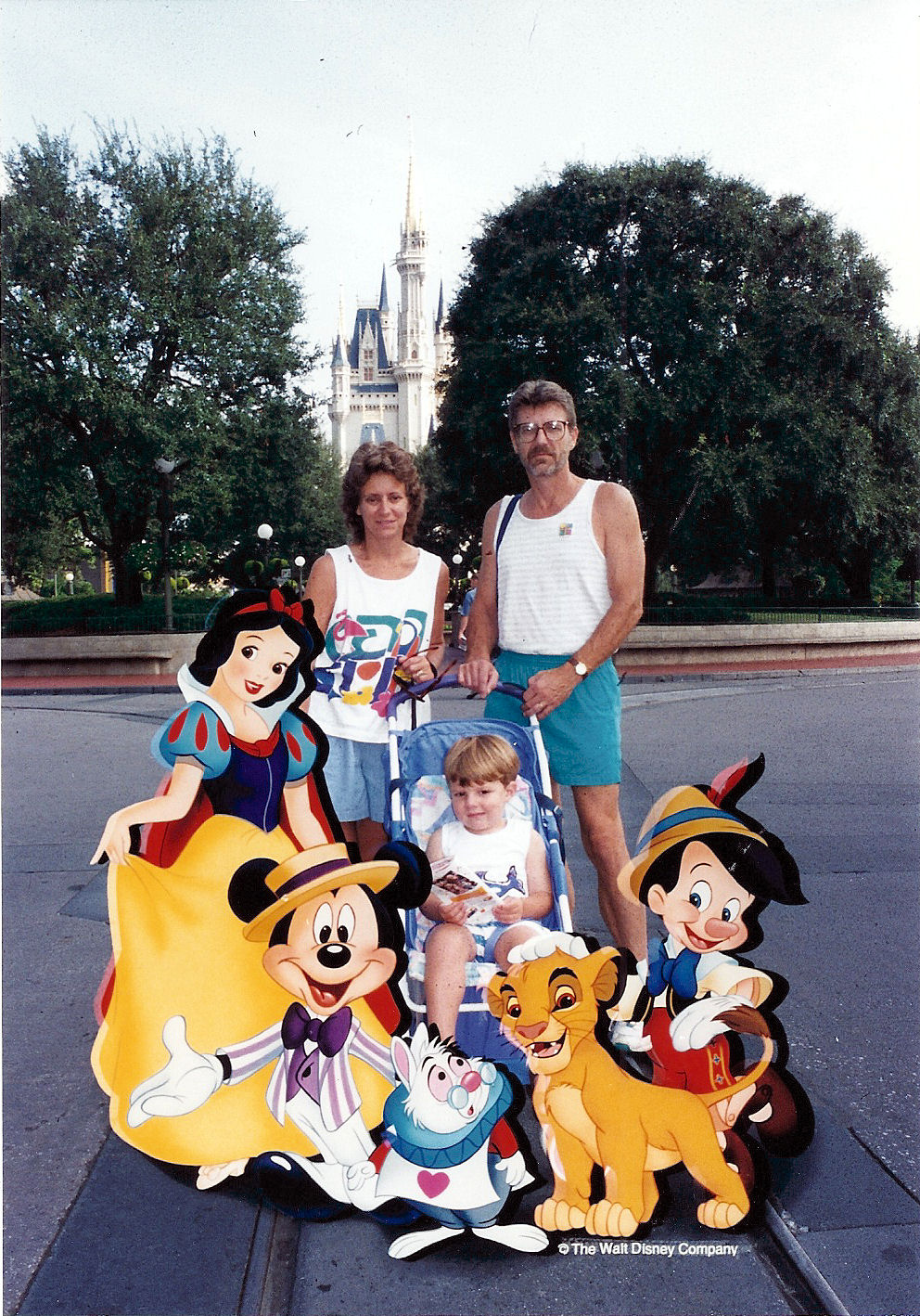 Max, Mom and Dad in with Disney characters.