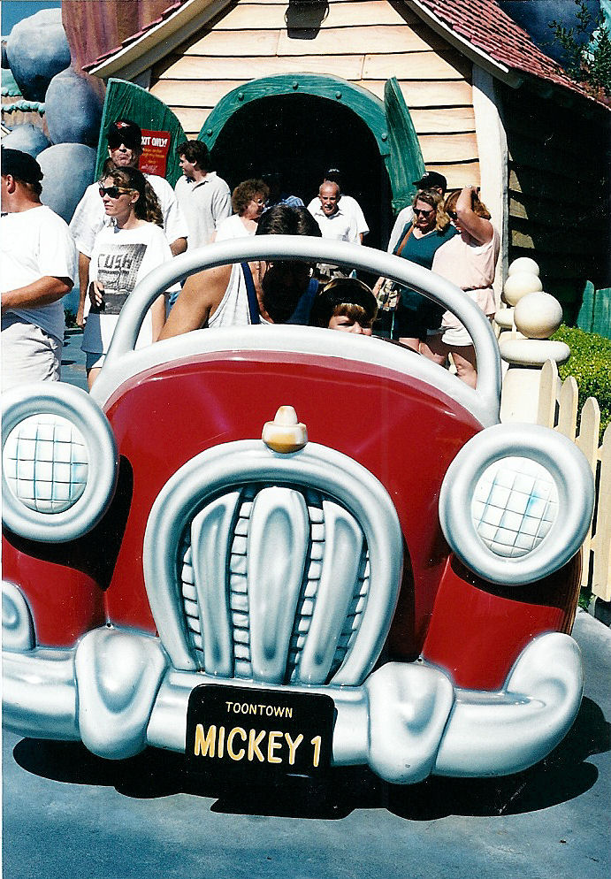 Max driving Mickey's car in Toontown.