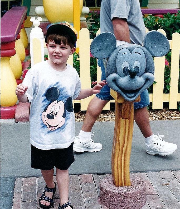 Me in front of Mickey's mailbox in Toontown Fair.