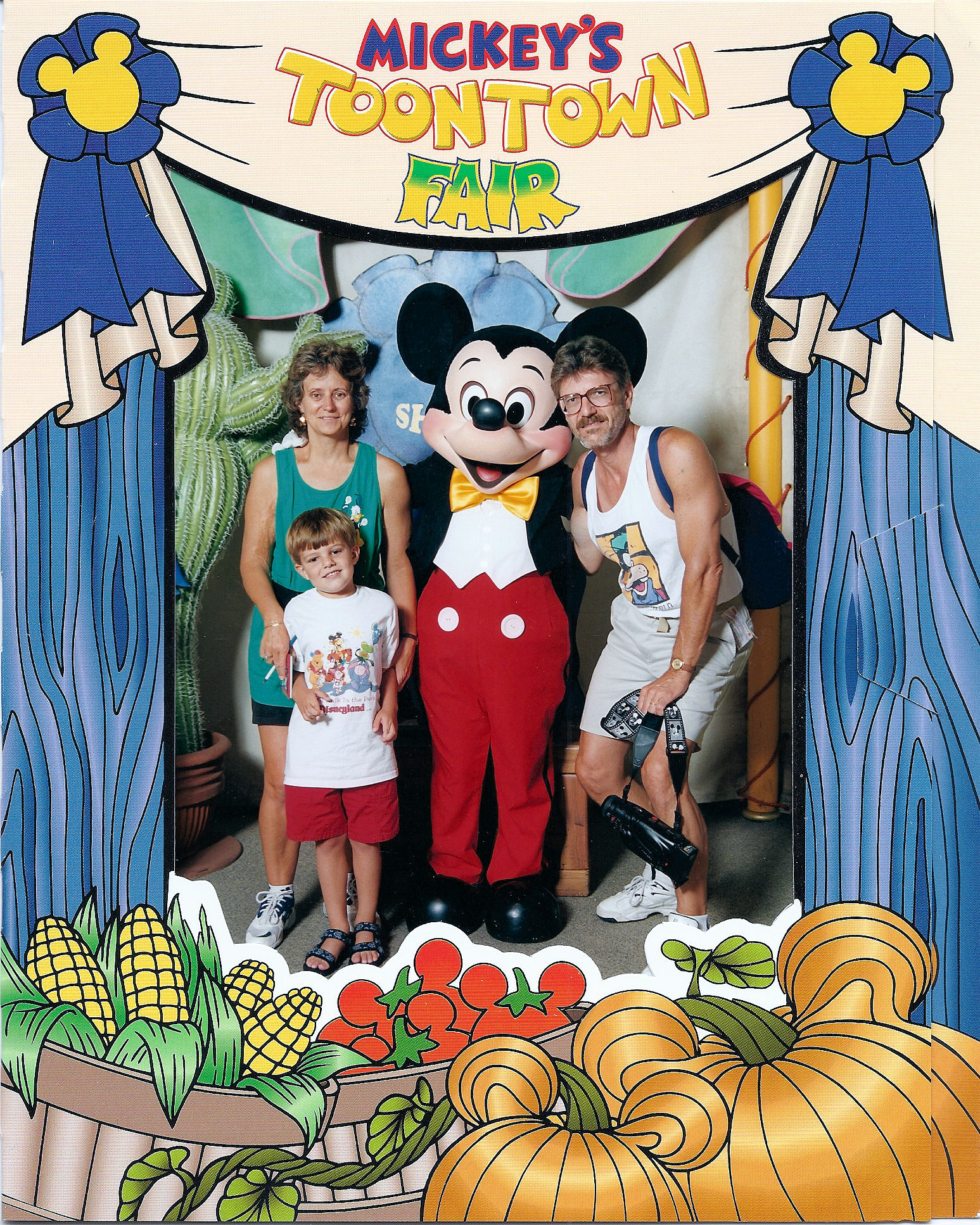 My parents, Mickey Mouse, and I at Mickey's Fair at The Magic Kingdom, Walt Disney World.