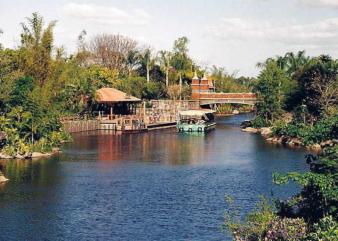 A river in Disney's Animal Kingdom with a boat on it in Walt Disney World.