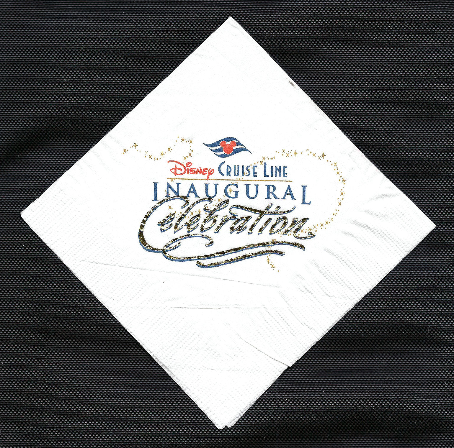 A napkin honoring the Disney Cruise Line's inaugural celebration.