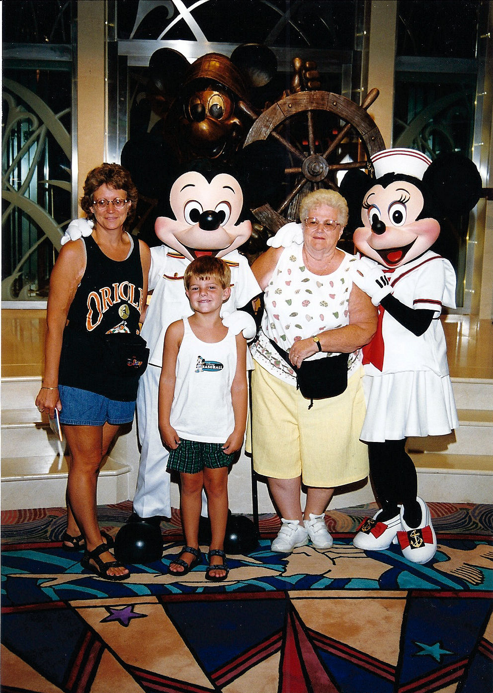 Me, my mother, and my grandmother with Mickey and Minnie on the Disney Cruise Line.