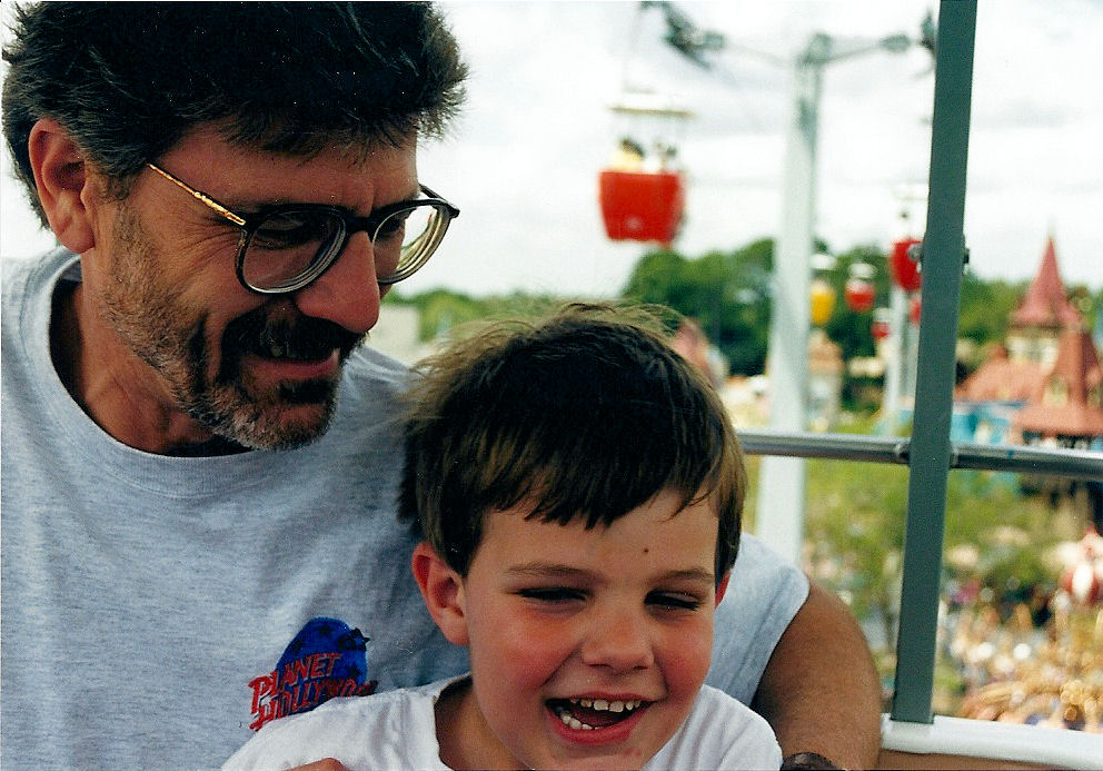 My dad and I on the skyway over The Magic Kingdom at Disney World.