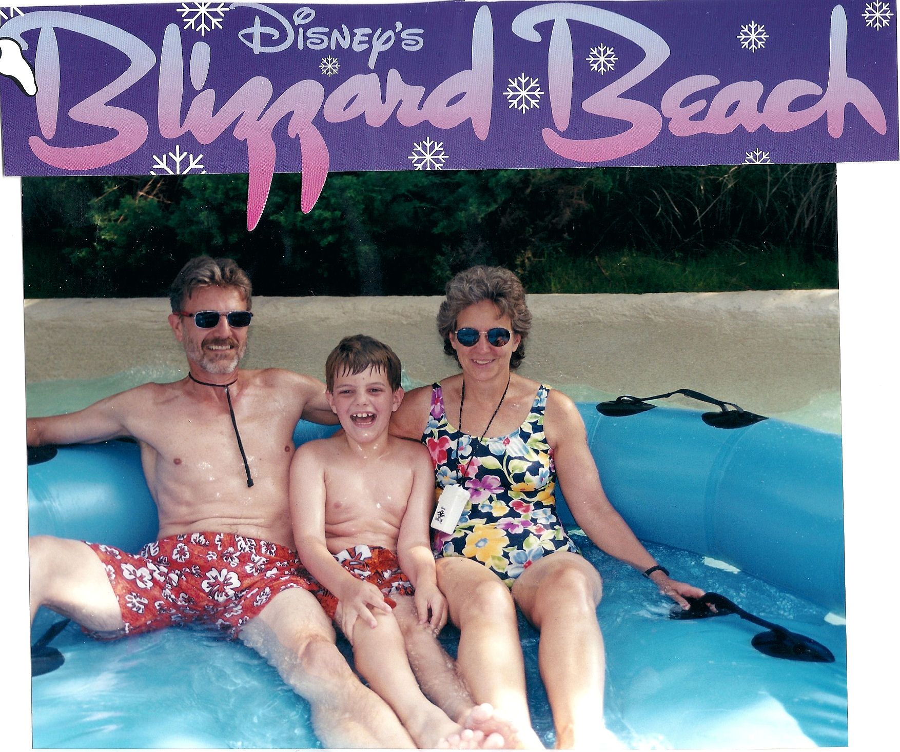 Me and my parents at Blizzard Beach, a water park at the Disney World Resort, just after riding the raft ride.