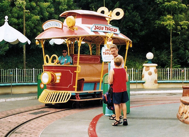 My dad and I by a Jolly Trolly in Mickey's Toontown at Disneyland.