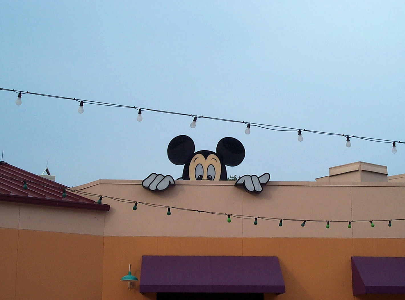 Mickey peeking over the wall at Pleasure Island, Downtown Disney, Disney World.