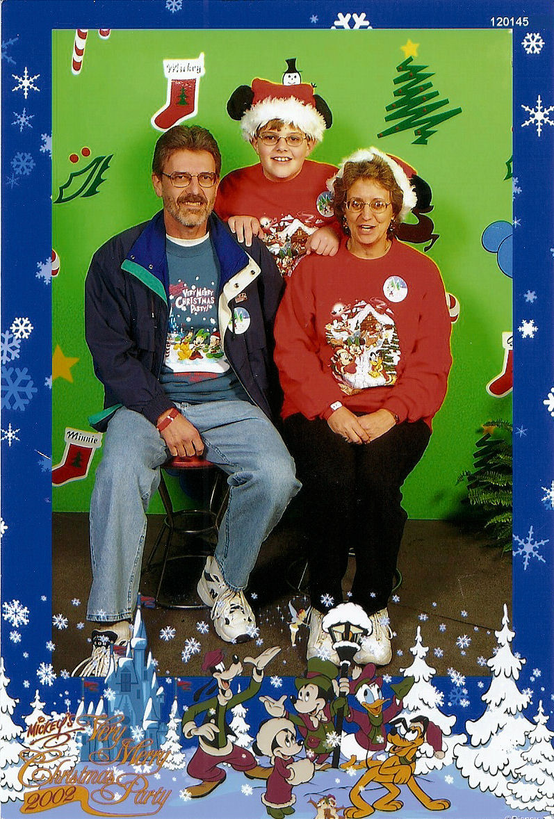 My parents and I in a souvenir photo taken during Mickey's Very Merry Christmas Party at The Magic Kingdom at Disney World.
