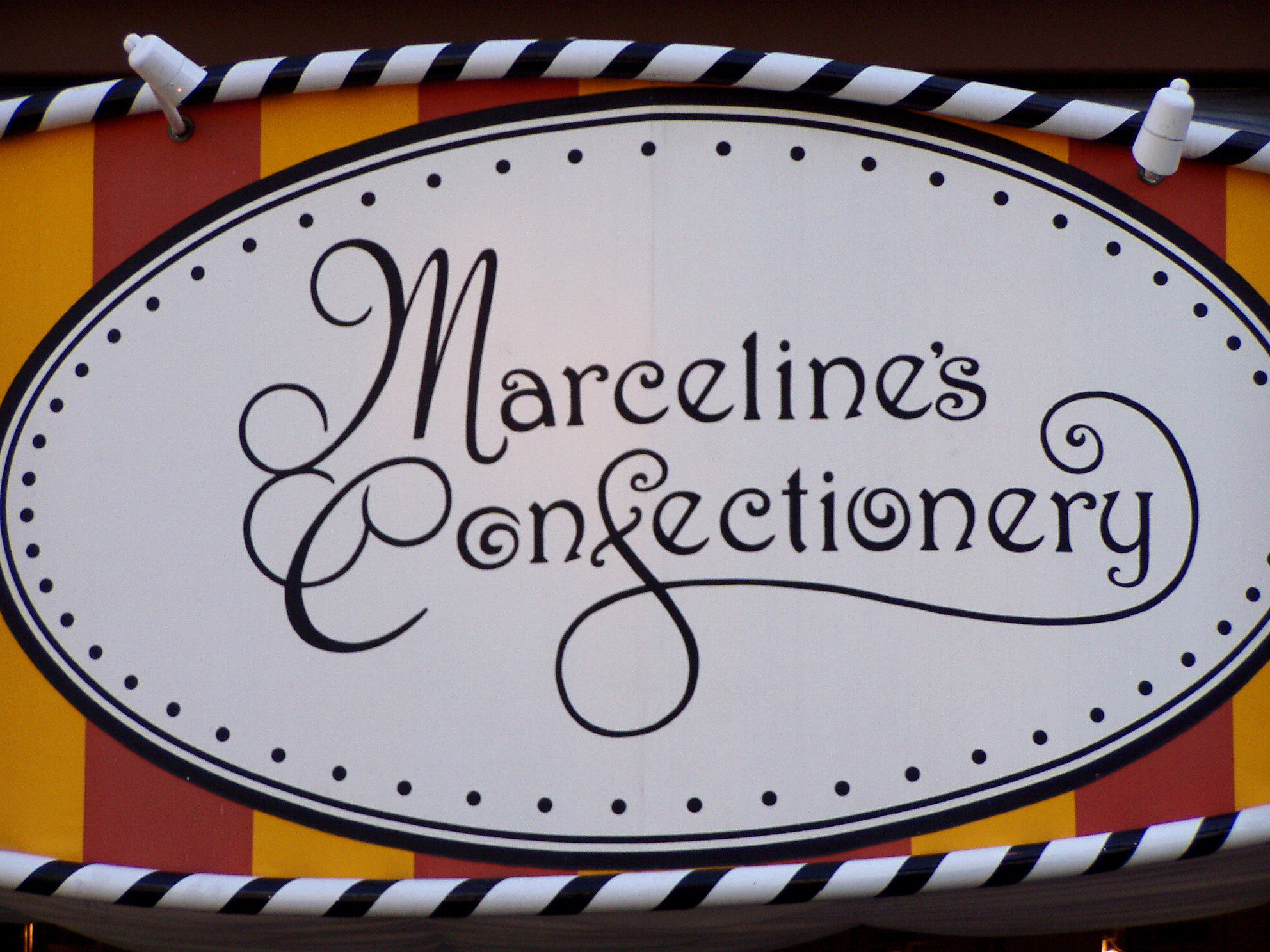 A Hidden Mickey in the logo for Marceline's Confectionery at Downtown Disney at The Disneyland Resort.