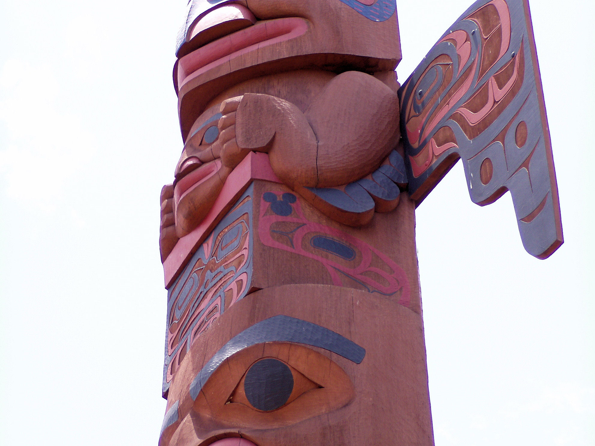 A Hidden Mickey on a totem pole in the Canada Pavilion at EPCOT.