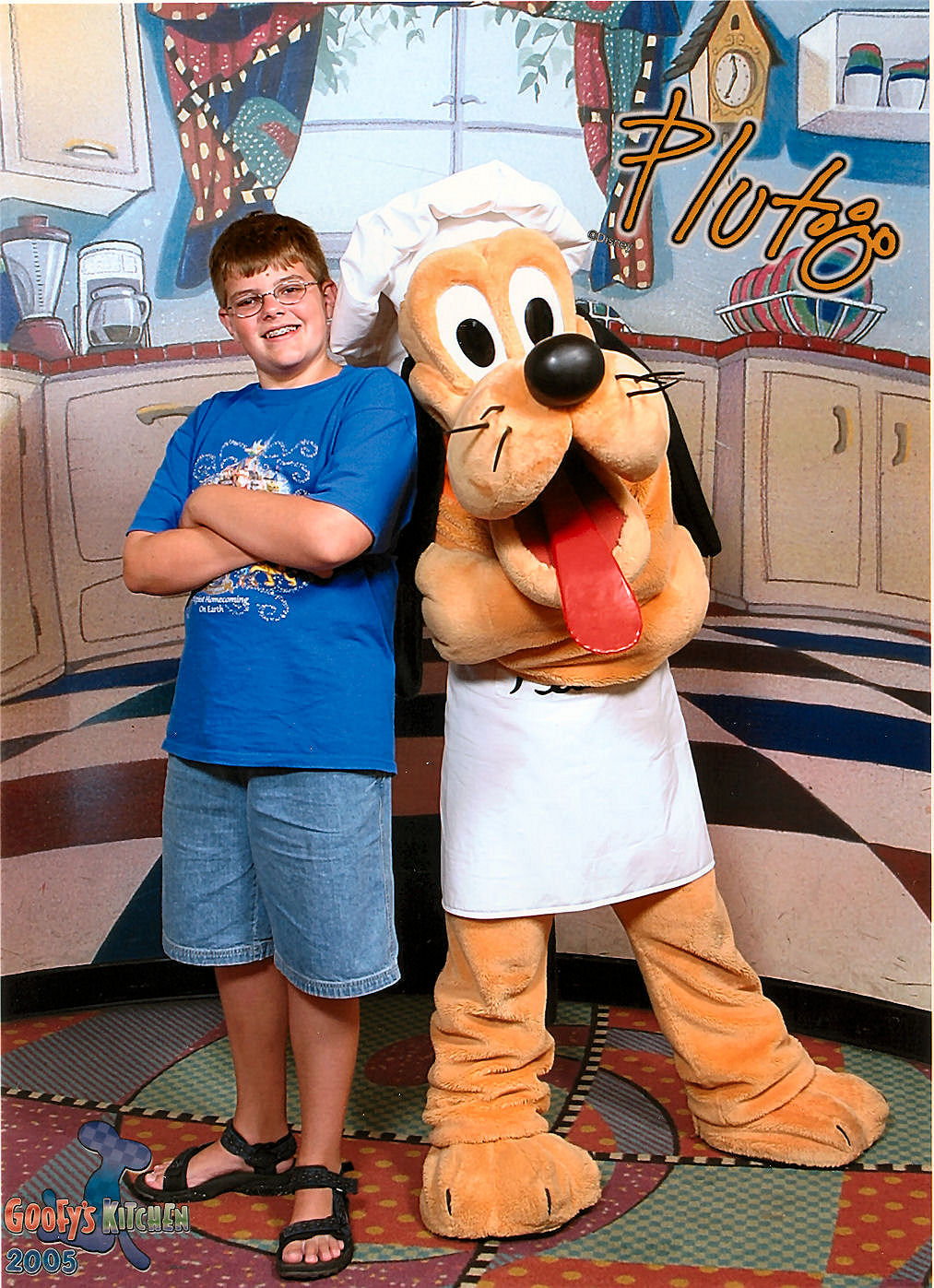 Pluto and I in a souvenir photo taken at Goofy's Kitchen, a character meet and greet dinner at the Disneyland Hotel.