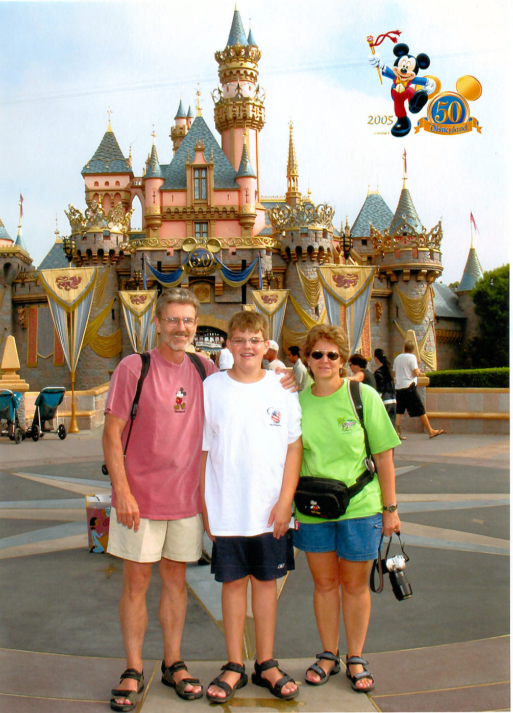 My parents and I in front of Sleeping Beauty Castle at Disneyland during The Happiest Celebration on Earth celebration.