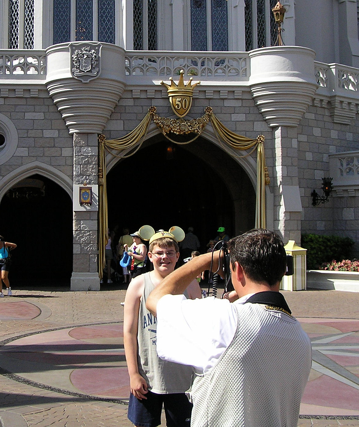 Me getting my picture taken behind Cinderella Castle with my golden Mickey Ears on at Disney World.