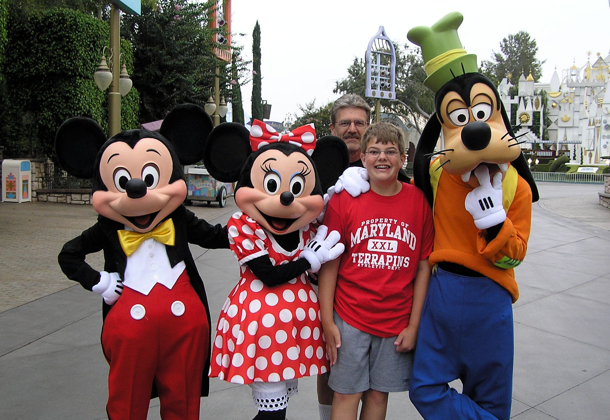 Me and my dad with Mickey, Minnie, and Goofy at Disneyland.