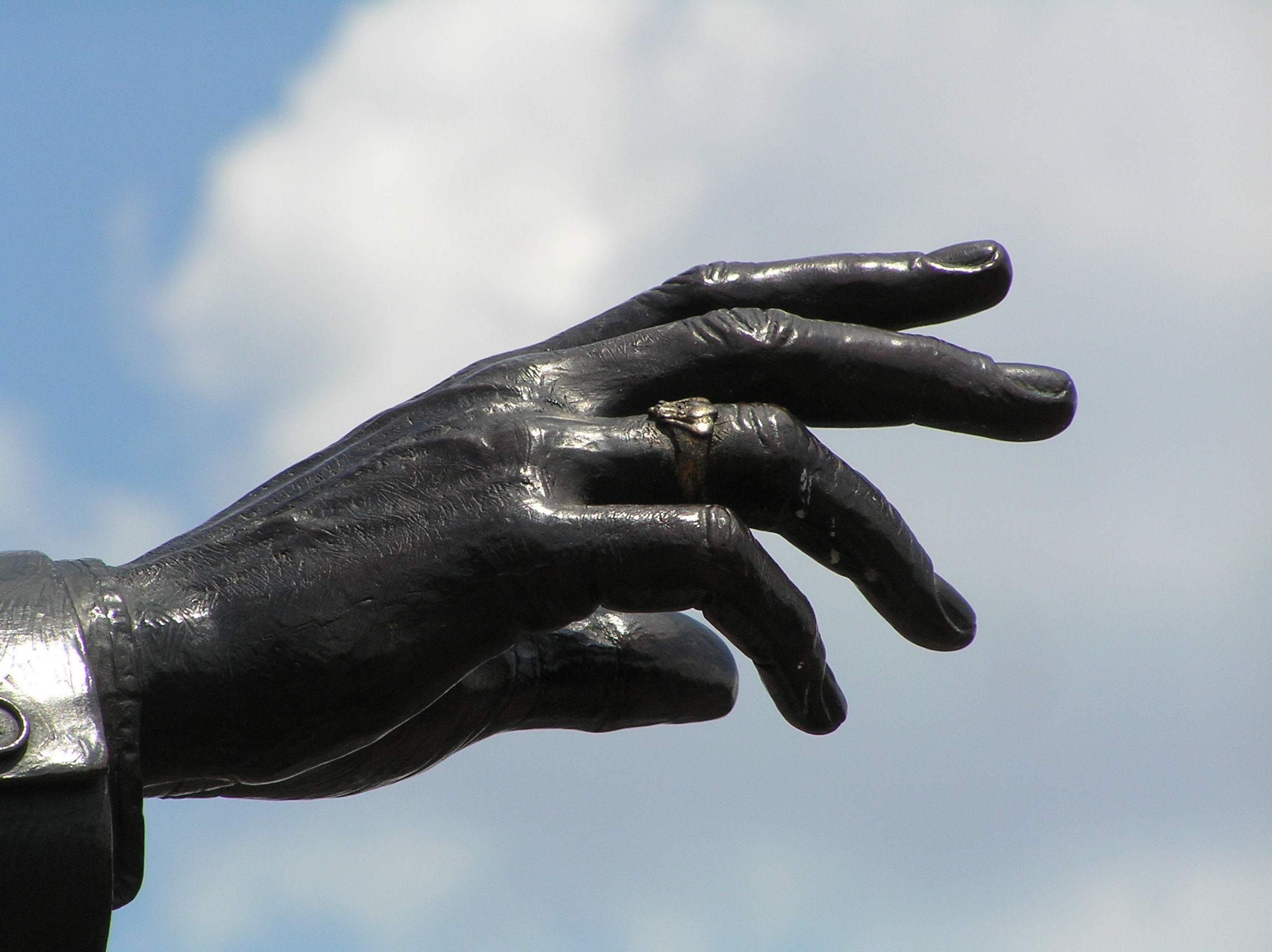 Walt Disney's outstretched hand on the Partners' Statue at The Magic Kingdom at Disney World.