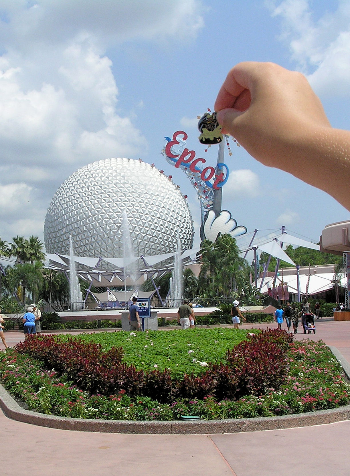 The Big Ball with the Mickey hand on it at EPCOT with me holding a pin in front of the top of the wand.