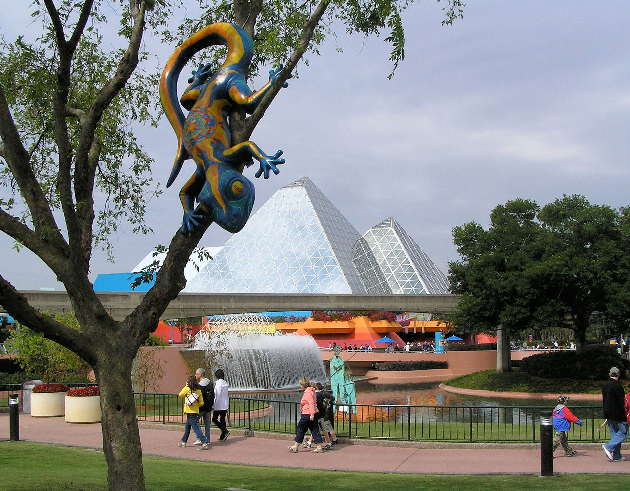 A gecko in a tree in front of the Imagination Pavilion at EPCOT.
