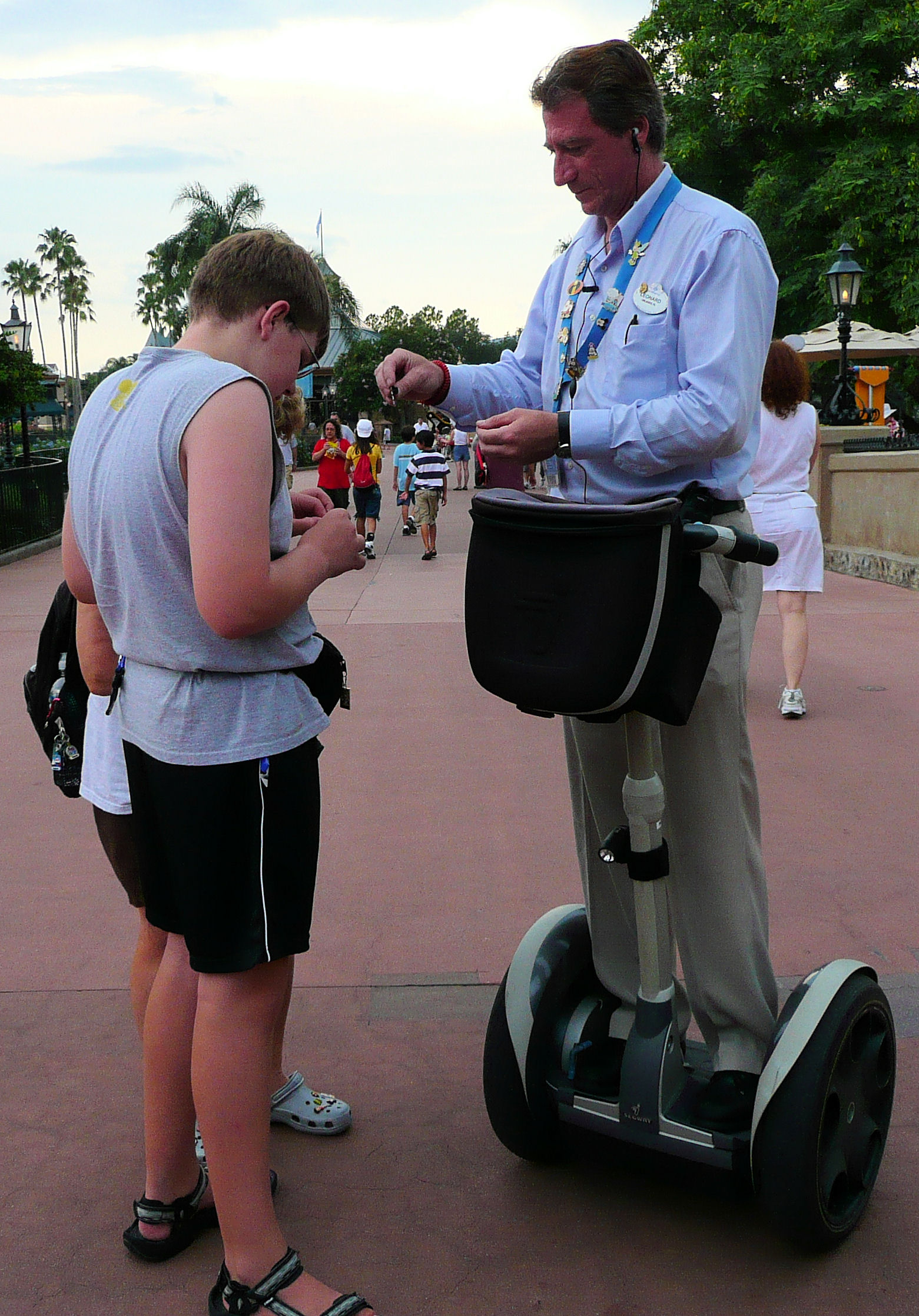 Pin trading with a cast member on a Segway.