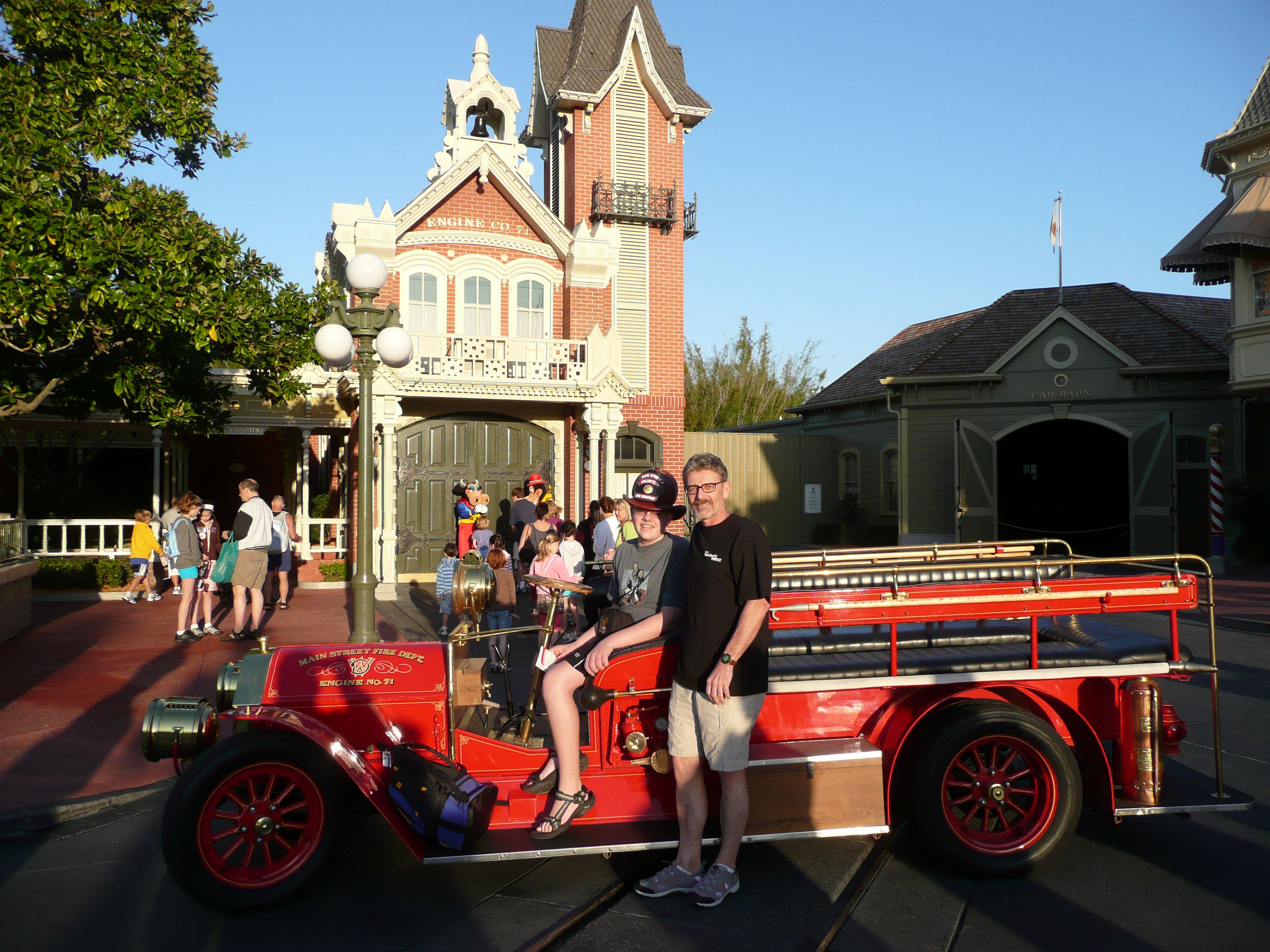 Main Street, USA at Disney World; Dad and I with a fire truck with me wearing a fireman's helmet.