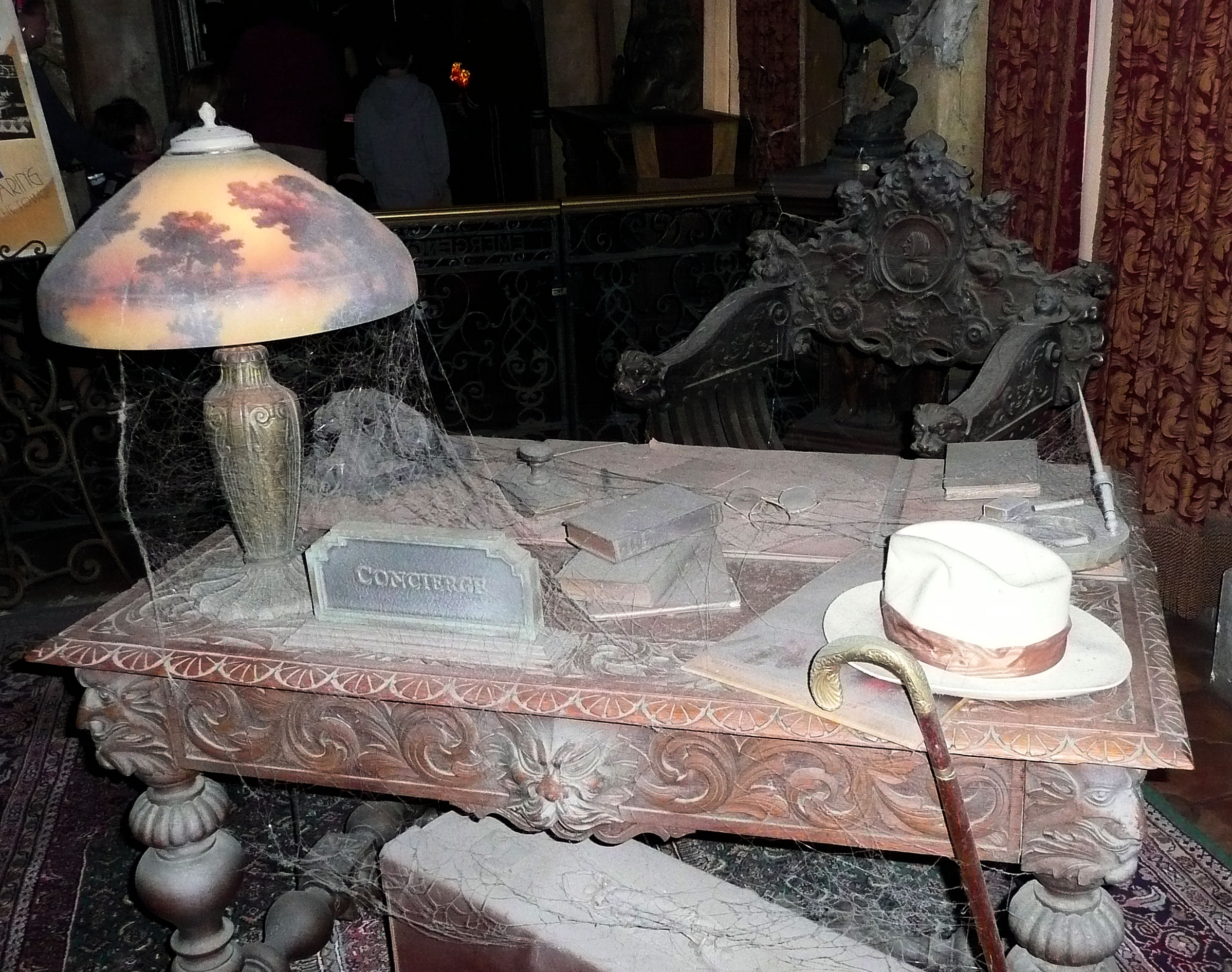 Hidden Mickey in the lobby of the Twilight Zone Tower of Terror; it's to the right of the books in the middle of the desk and is made out of eye glasses.