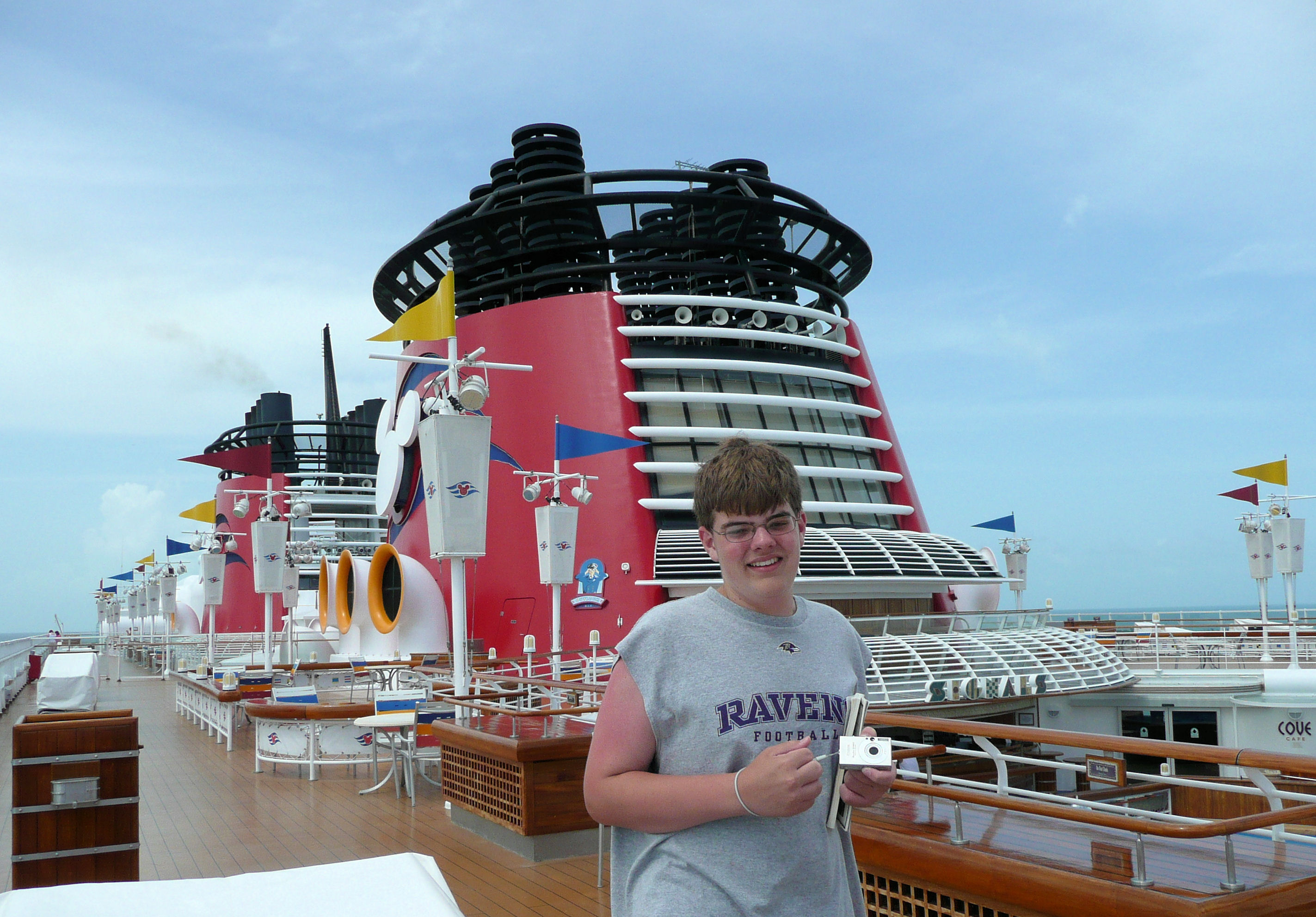 On the top deck enjoying the view on the Disney Cruise Line.