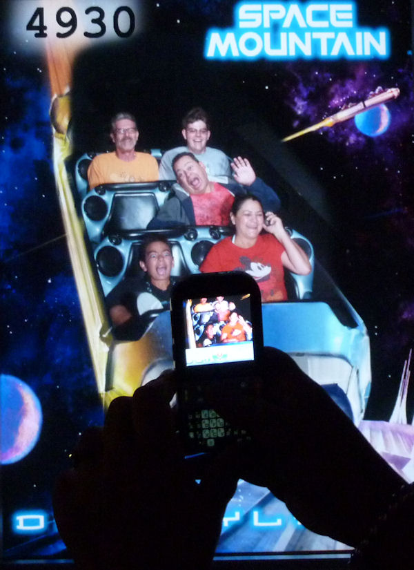 Riding side-by-side, Space Mountain Disneyland.