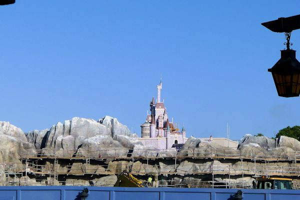 Peaking over the construction fence in Fantasyland.