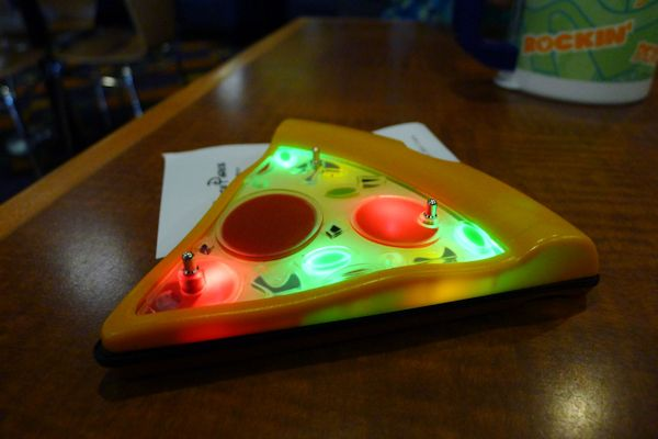 The pizza slice blinks and buzzes when the pizza's ready.
