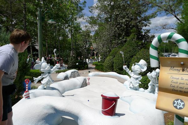 Playing miniature golf at Disney's Winter Summerland near Blizzard Beach.