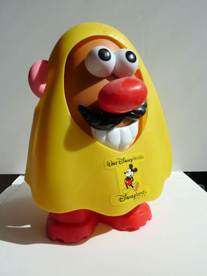 Mr. Potato Head in Disney rain poncho.