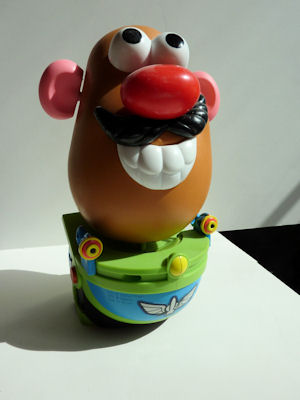 Mr. Potato Head ready to ride Buzz Lightyear's Space Ranger Spin.